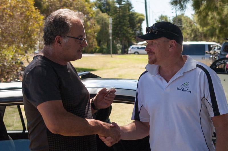 Phil Devenish (Lara's farther) congratulates the winner of Laras Race Dave Simmons