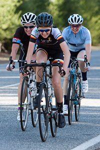 3 women riders smiling