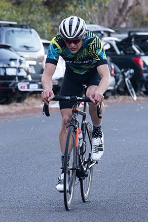cyclist grimancing
