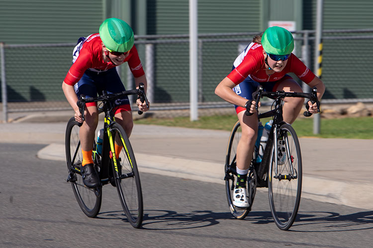 two junior cyclists sprinting for the line