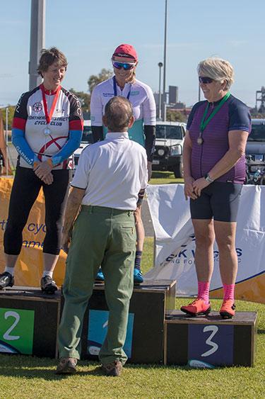 three women cyclists on the podium