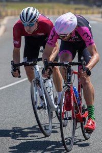 two cyclists sprinting