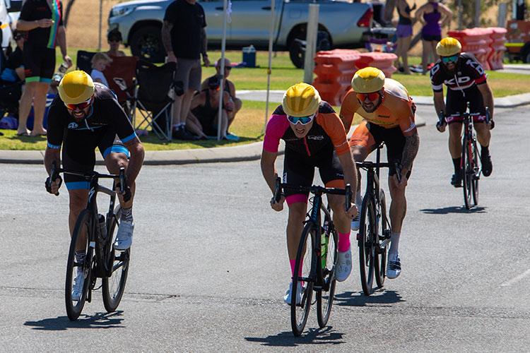 4 cyclists sprinting
