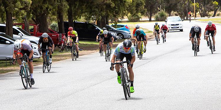 Racing cyclists sprinting